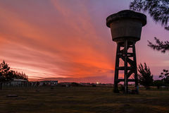 Sunset and Water Tank Atlantida Brazil Stock Photography