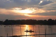 Sunset waterfront ship. At evening Stock Photos