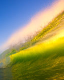Sunset Wave. Breaks in Ocean with Beautiful Light Royalty Free Stock Photo