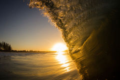 Sunset and the wave. Wave breaking on sunset in byron bay, new south wales, australia stock images