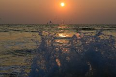 Sunset wave at Goa stock images