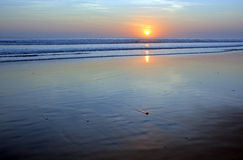 Sunset and wave patterns at Low Tide on Legian Beach, Bali, Indo Stock Photos