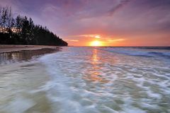Sunset and waves. Sunset with waves as a foreground in Sabah Borneo Stock Photo