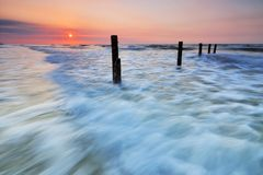 Sunset and waves. Sunset with waves as a foreground in Sabah Borneo stock images