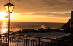 The sunset. In the waves Royalty Free Stock Photography
