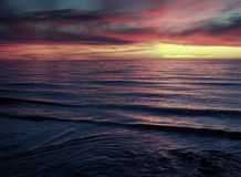 Sunset Waves. Sunset over peaceful beach royalty free stock images