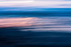 Sunset on the waves abstract stock photography