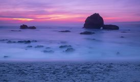 Sunset and waves on the beach in biarritz. France stock photography