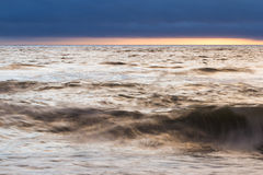Sunset and waves Royalty Free Stock Image