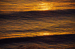 Sunset and waves Stock Photography