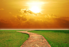 Sunset way background. Way background sunset brick walkway sun destination lawn green grass Stock Photo
