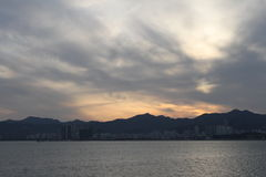 The sunset of weihai. Standing on the Liugong Island, opposite the view of the city(Sino Japan Jia Wu naval battle occurred in the island Stock Images