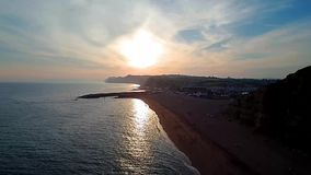 Sunset at West Bay Dorset. Aerial drone view of setting sun over West Bay, on the Dorset Jurassic Coast stock video