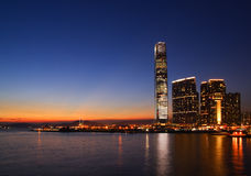 Sunset of West Kowloon Cultural District and Victoria Harbor, Hong Kong Stock Photo