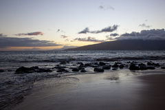 Sunset on the West Maui Mountains. Sunset on the beaches of Kihei, Maui, Hawaii with the West Maui Mountains in the distance stock photography