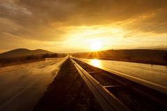 Sunset on wet road Royalty Free Stock Photo