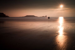 Sunset and wet sand at Worms Head Royalty Free Stock Photography