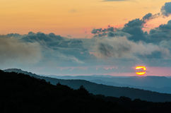 Sunset, White Rocks overlook, Cumberland Gap National Park. The summer sun sets over the Cumberland Plateau. This scene was captured from top of the White Rocks Stock Photos