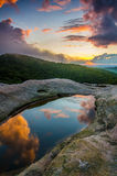 Sunset, White Rocks overlook, Cumberland Gap National Park. The summer sun sets over the Cumberland Plateau. This scene was captured from top of the White Rocks Stock Photography