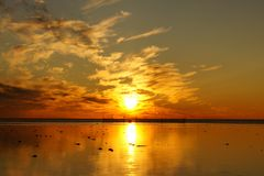 Sunset and White Sea in summer season Royalty Free Stock Image