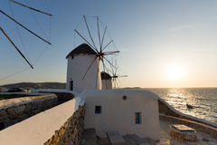 Sunset at White windmill on the island of Mykonos, Cyclades Royalty Free Stock Images
