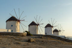 Sunset at White windmill on the island of Mykonos, Cyclades Stock Photos