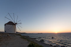 Sunset at White windmill on the island of Mykonos, Cyclades Islands Royalty Free Stock Photos