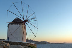 Sunset at White windmill on the island of Mykonos, Cyclades Islands Stock Images