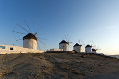 Sunset at White windmill on the island of Mykonos, Cyclades Sunset at White windmill on the island of Mykonos, Cyclades Stock Photos