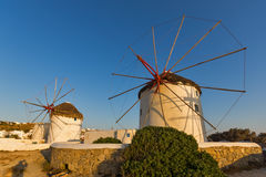 Sunset of White windmills and Aegean sea on the island of Mykonos, Greece Stock Photography