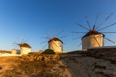 Sunset of White windmills and Aegean sea on the island of Mykonos, Greece Royalty Free Stock Image