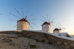 Sunset of White windmills and Aegean sea on the island of Mykonos, Greece Royalty Free Stock Photo
