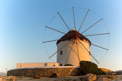 Sunset of White windmills and Aegean sea on the island of Mykonos, Greece Stock Images