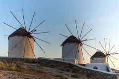 Sunset of White windmills and Aegean sea on the island of Mykonos, Greece Stock Image