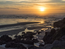 Sunset on a wide beach Stock Photography