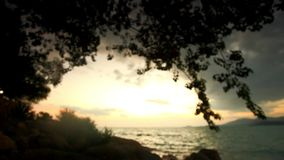 Sunset on a wild beach in Thailand. Blurred stock video footage