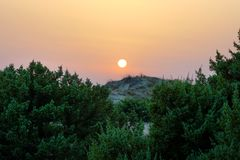 Sunset on the wilderness and natural area of Chalikounas in Corfu. Greece view sailing coastline landscape relaxation greek mountain port forest tourism island stock image