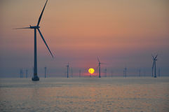 Sunset at Wind park Roedsand 2 DK Stock Photos