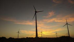 Sunset through wind poll stock photos