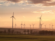 Sunset wind turbines royalty free stock images
