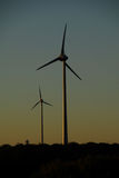 Sunset in a windfarm. Royalty Free Stock Photography