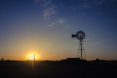 Sunset with windmill Stock Images
