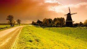 Sunset windmill landscape stock photo