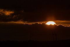 Sunset with windmills Royalty Free Stock Photo
