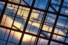 Sunset Through A Window. Street Photo. Detail of a sunset visible through windows Royalty Free Stock Image