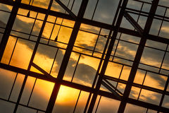 Sunset Through A Window. Street Photo. Detail of a sunset visible through windows Royalty Free Stock Photography