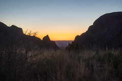 Sunset at the Window View of the Chisos Mouontains in Big Bend National Park. Setting sun in the Chisos Basin of Big Bend National Park Royalty Free Stock Images