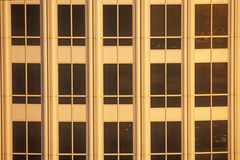 Sunset in windows of office building Royalty Free Stock Photography