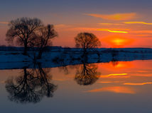 Sunset in winter. Winter sunset at the river Stock Image