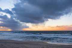 Sunset at winter beach Sylt, Germany Royalty Free Stock Images
